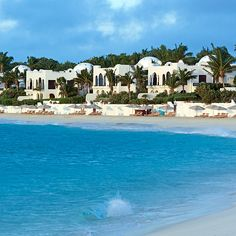Brides.com: . 5. Cap Juluca, Anguilla    Fresh off a $12 million facelift, this luxe Greco-Moorish gem was made for honeymooners—and A-listers! (Brad Pitt, Penelope Cruz, and Harrison Ford have all escaped here.) At night, you'll sleep your wedding stress away in a king-size bed kitted out with Frette linens. By day, it's all about Maundays Bay's perfect sweep of sand. Ride horses in the surf, hit one of five beach bars, or just relax on a chaise lounge and let staff bring the chilled towels…
