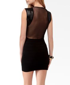 Super sexy little black dress. Backless with sequin soldiers, (honeymoon date??)