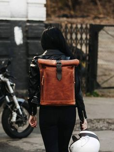 This backpack is designed and handcrafted in our atelier. We use use genuine leather, that only looks better with age and usage.  This urban daily pack closes with roll up and two leather strap with buckle. It has pass through pocket worth YKK zippers on both sides.  The shoulder straps are adjustable with a leather strap and buckle. All stress points are reinforced with extra stitching and rivets.  Inside is this bag fully lined with denim. It has one roomy compartment and one cell phone…