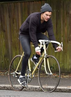 On your bike! Harry Styles clearly likes to keep it real - as he proved ee21d5a551b35