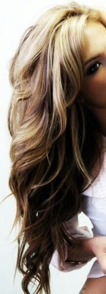 Brown hair with blond high lights and with pretty hair curls.