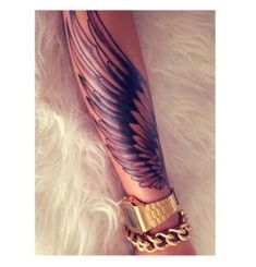 Winged arm tattoo for females.