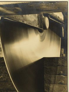 """Margaret Bourke White (American, 1904-1971) warm-toned silver gelatin print, pencil signed lower right margin and labeled on back, """"A Margaret Bourke-White Photograph"""" and """"Diamond Edge Saw Indiana Limestone Company"""". Mounted on cardstock and unframed. Image – 13 3/8″ H x 9 3/8″ W. Sight – 15″ H x 10 1/2″ W. Circa 1931. Provenance: estate of Francis Edward Faragoh (1898-1966), American screenwriter. Condition: Some overall toning. Some rippling to print."""