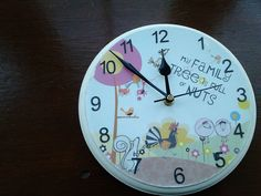 My Family Tree is Full of Nuts, 21cm Hand decorated clock £10 plus postage . This can be viewed in my Etsy shop or on my Facebook page, FelineFixins for both. I can customise to your spec.