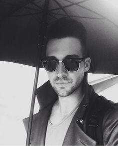 James Maslow under his umbrella