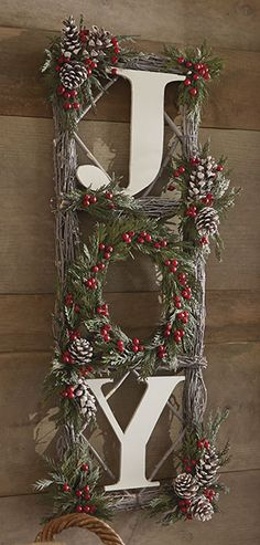 "Designed with natural twigs, green preserved cedar, snowy pinecones and faux red berries. A favorite holiday sentiment in white wooden letters. For indoor or outdoor (in protected area) use. 31""H x 12""W x 3""D. Avoid direct sunlight, heat or moisture."