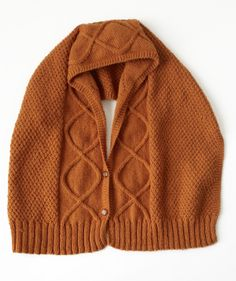 Featuring cables and moss stitch for great texture, you can wear this buttoned piece as a scarf, hood, or a gaiter/cowl for three different looks in one piece!