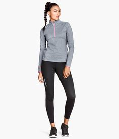 fd37e2f57f2 Gray running top with thermal lining and black winter exercise pants with  windproof panels.