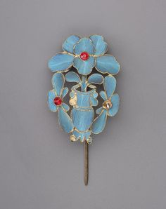 Hair ornament, China 1 BC to 1 AD, Kingfisher feather, gilt metal, glass and stone