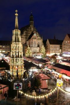 Christkindlesmarkt in Nurnberg, Germany and the beautiful fountain in the foreground