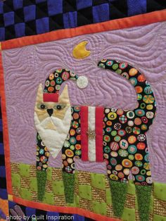 "Santa Claws, in:  ""Cats Rule"" by Kathy Mack, quilted by Shannon Freeman.  Folk Art Cats design by John Simpkins. 2014 RCQG, closeup photo by Quilt Inspiration"