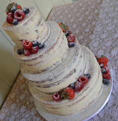 Semi-naked wedding cake decorated with fresh fruit. #weddingcake #seminakedcake