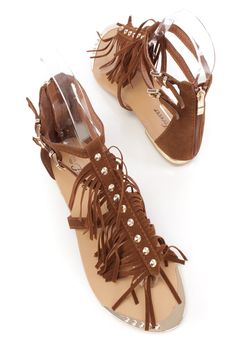 Update your spring wardrobe with these cute sandals featuring; faux suede, high polish spike studded, fringe detail, side buckle closures, high polish trim, back zipper closure, smooth lining, and cushioned footbed.