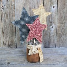 """Rustic Country """"America"""" Stars Jar, Patriotic, 4th of July decor, Red White and Blue, Americana Decor, USA. $19.95, via Etsy."""