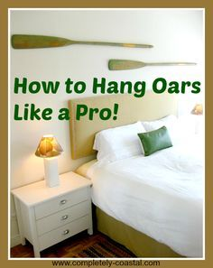 Learn how to hang oars like a pro! Easy and clean solution. Click here: http://www.completely-coastal.com/2014/03/how-to-hang-oars-on-wall.html
