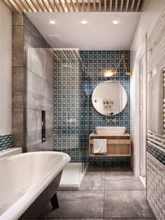 glass shower, interesting washstand, blue gray tile, stand alone tub master bathroom
