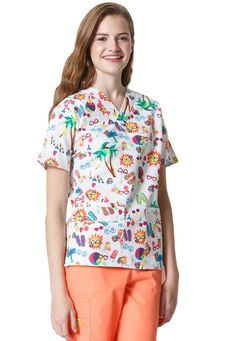 Style Code: This HedgeHog Bob print is long. This top has 5 pockets: 2 lower pockets including 1 signature triple pocket with a hidden mesh pocket. It has Invisible 3 part accessory loop and signature ID bungee loop. It is constructed with cotton. Scrub Tops, Scrubs, Floral Tops, Men Casual, U2, The Originals, Origins, Stylish, Nursing