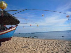 Tilly - Lanterns tied to bamboo on Phu Quoc island