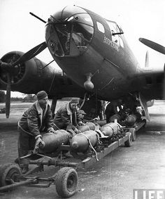 "centreforaviation:  Bombs being loaded onto the B-17 ""Boomerang"""