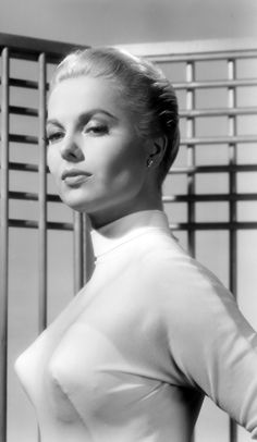 """Martha Hyer models a cone or """"bullet"""" bra clearly visible through a sheer turtleneck sweater. #sweater girls Sweater Girls and Bullet Bras #bulletbra #secretsinlace"""