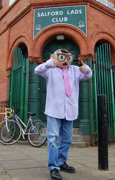 """""""Frank Sidebottom as Morrissey, outside Salford Lads Club. From the documentary Being Frank: The Chris Sievey Story"""" Manchester England, Manchester City, Frankly Mr Shankly, Altrincham, Salford, Modern City, Clothing Company, Will Smith, Humor"""