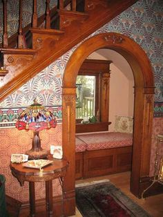 Reading nook under the stairs. For reading Harry Potter obviously