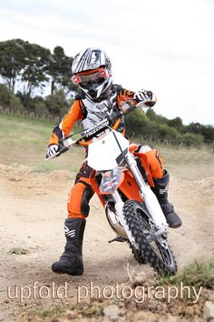 Mini motocross in Auckland, New Zealand, young child riding a KTM 65 SX. Image by Upfold Photography, Auckland. ~ Mini motocross photography ~