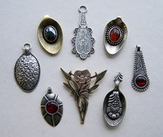 New pendants what i made for local Christmas sales etc. I use old teaspoons, silver/brass plates & wires etc. And this time i attach also some stones to my pendants. (Oval hematite/carneol cabo...