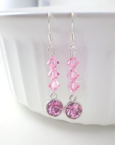 These gorgeous, sweet pink earrings are made with high-quality swarovski light rose (6mm) bicone beads and light rose charms. These light/pale pink earrings make a fantastic gift and come ready in a cute organza bag.  LENGTH: 2 inches total (ear wire to lowest bead)
