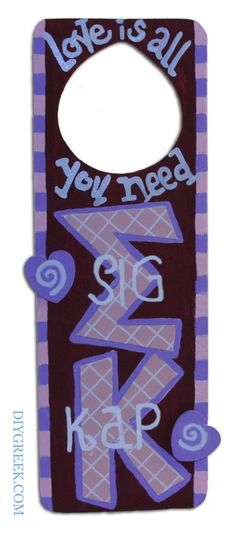 SK  Sigma Kappa Door Hanger.  Another cute example made with DIYGreek.com Supply Sack.  Used the Custom Stencils to Trace on the included Paper.  Used the wooden hearts, paint pen, paints.