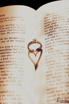 playing with light and shadow, heart shape, ring in book, sepia