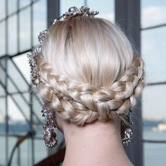 Crisscross crown braids look like theyre fit for royalty. #hair #weddinghair #braids #inspriation #style #updo #bride #bridetobe #bridalbling Photo by: @firstviewphoto via @angela4design