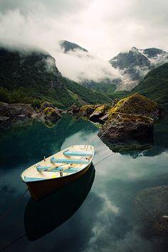 boat on lake bondhusvatnet, folgefonna national park, norway