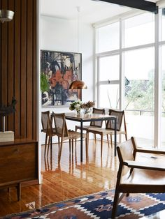 Tim Ross and Michelle Glew-Ross Home - Sydney_The Design Files_ Grant Featherston Delma table (the sort that used to be in school libraries) and four '60s/early '70s chairs made by Sydney designer John Duffecy