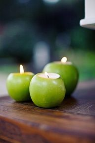 """apple candles: do it with oranges for the """"pumpkin"""" carriages, for cinderella twilight garden party...."""