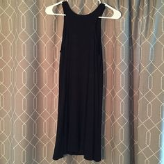 Florencia Arias little black dress NWT Cute little black dress with interesting neckline and open back. New with tags! Awesome brand based in Hawaii. Florencia Arias Dresses Mini