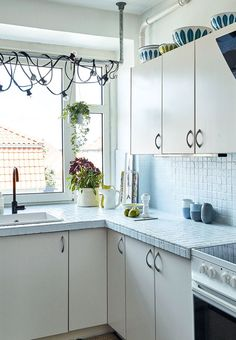 Decorative and feminine kitchen with tiles in a delicate blue colour.