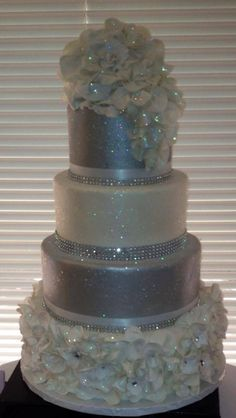This is the idea im going for...but only the bottom two tiers, square, and both being white and sparkly