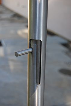 Integrated cane bolt housed in a door handle for a gate. All Stainless steel  Designed by Formed Objects