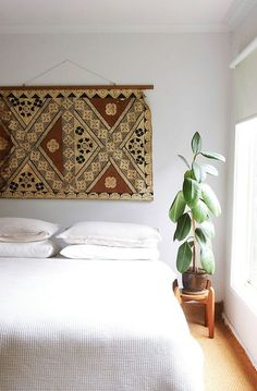 such a nice touch - tapestry headboard