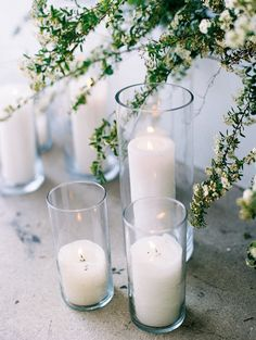 white pillar candles for a wedding ceremony
