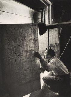 Howard Carter Looking through the Open Doors of Tutankhamun's Second Shrine