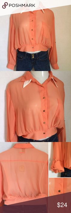 Alythea peach chiffon blouse NWT Alythea button front chiffon peach cropped blouse. Breast pocket and optional roll tab sleeves. Material has a slight snag visible along length of the button placket, as shown in 3rd picture. Size S. 100% polyester. NWT. Not interested in trades. Alythea Tops