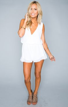 "Crossover top, ruffled around the edges, this bohemian dream romper will leave you (and everyone who sees you) speechless. Whether you wear her to a music festival, a day at the resort, to your bridal shower or even just to class the RiRi Romper is a timeless piece, you'll be RiRi wearing her for ages.	   *MADE IN THE GORGE USA* *100% Poly Chiffon *Button in back  *Elastic Waist  *Lined *Basically Wrinkle-proof. Throw in purse for later recommended  Kylie is 5'5"" her measurements are…"