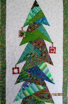 "Kaffe Fassett Christmas tree wall hanging by Shelley at Waterwheel House Quilt Shop: paper pieced  ""Tall Trim the Tree"" pattern by Cindi Edgerton ( 76"" tall!)"