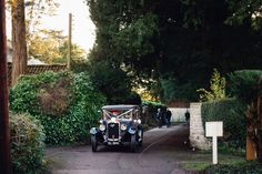 vintage car arrives at st leonards