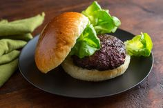 I incorporated a roasted beet into the beef and roasted mushroom mix, allowing me to shave another couple of ounces of beef off the formula, and the resulting burger is a winner. The beet contributes moisture, texture and great color – almost a rare meaty look – to these almost-veggie burgers. (Photo: Andrew Scrivani for The New York Times)