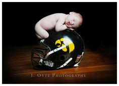 Baby on Helmet.  hmmm... how'd they do that?  My guess is photoshopping out mom or dad's hands in the back...  maybe???