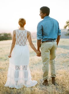 Remember that a shot from the back can be just as stunning as one from the front when you have details like this to show off. It's also another example of how romantic a white dress can be for the shoot.   Source: Joel Serrato Filmas via Style Me Pretty