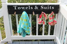 "Rather than have your kids drop their towels on the ground in a wet, soppy mess, hang this cute ""rack"" to keep suits and towels organized.  Get the tutorial at The Summery Umbrella."